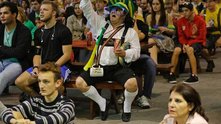 Brazilians of German descent watch the World Cup semifinal match between Brazil and Germany on a screen in Blumenau, Brazil, Tuesday, July 8, 2014. The German community in southern Brazil organized an Oktoberfest party to watch the match. Germany won 7-1. (AP Photo/Nelson Antoine)