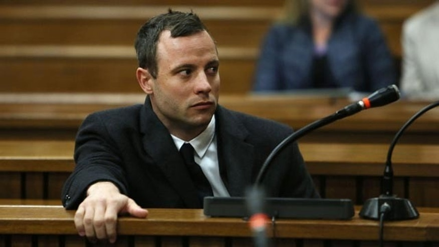 July 8, 2014: Oscar Pistorius attends court at his murder trial for the shooting death of his girlfriend Reeva Steenkamp on St. Valentine's Day 2013 in Pretoria, South Africa. (AP Photo/Alon Skuy, Pool)