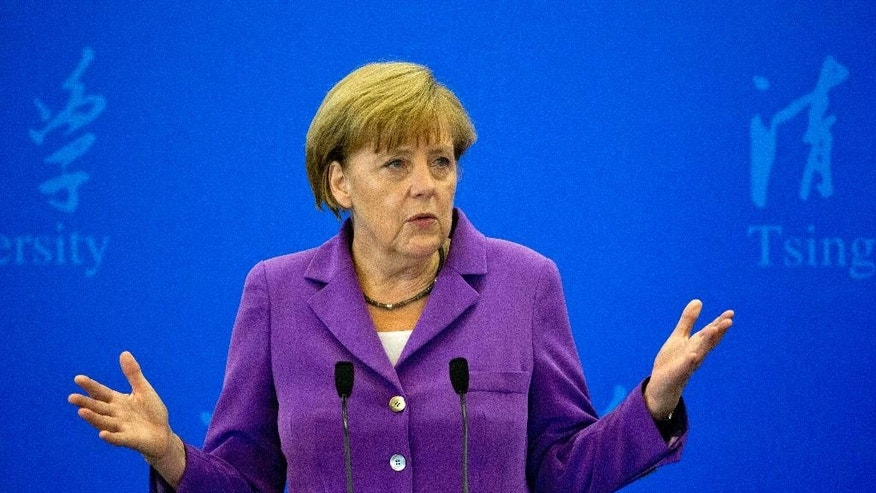 German Chancellor Angela Merkel delivers a speech at Tsinghua University in Beijing, China, Tuesday, July 8, 2014. (AP Photo/Ng Han Guan)