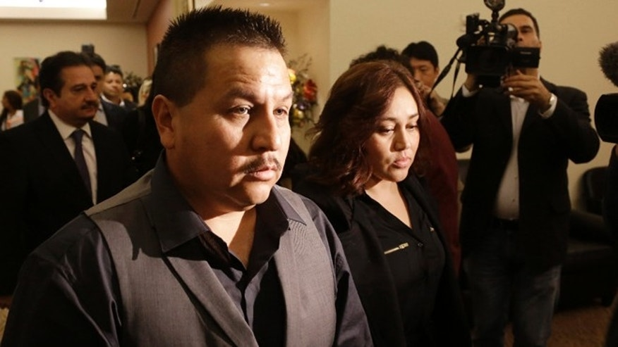 File - This Nov. 4, 2013 file photo shows Rodrigo Lopez, left, and Sujay Cruz, parents of Andy Lopez, as they walk to a news conference in San Francisco. Prosecutors said Monday, July 7, 2014, that they will not file criminal charges against a Northern California sheriff's deputy who shot and killed Andy Lopez, an unarmed 13-year-old boy, whose death last year sparked protests and criticism that the officer acted too quickly. (AP Photo/Jeff Chiu, file)