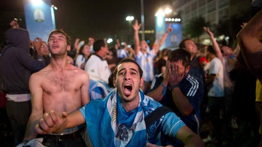 Fans of the Argentina national soccer team celebrate after their team defeated The Netherlands during the semifinals match, during the 2014 soccer World Cup, at the FIFA Fan Fest in Sao Paulo, Brazil, Wednesday, July 9, 2014. Argentina made it to the World Cup final with a 4-2 shootout win over the Netherlands after the game finished in a 0-0 stalemate. (AP Photo/Rodrigo Abd)