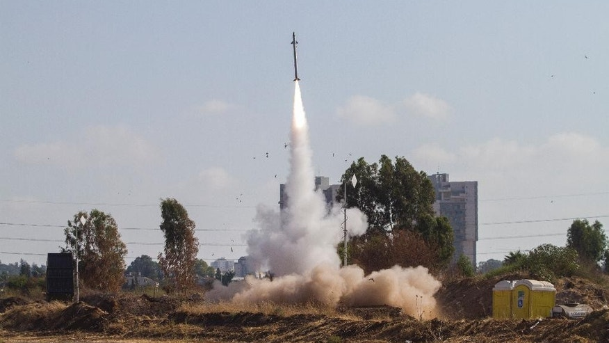 An Iron Dome air defense system fires to intercept a rocket from the Gaza Strip in Tel Aviv, Israel, Wednesday, July 9, 2014. Besides firing toward Israel's two largest population centers in Tel Aviv and Jerusalem, Hamas also fired one rocket that reached the northern Israeli city of Hadera for the first time, effectively putting the entire country under rocket range from the north and south.  (AP Photo/Dan Balilty)