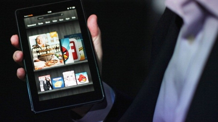 NEW YORK, NY - SEPTEMBER 28:  The new Amazon tablet called the Kindle Fire is displayed on September 28, 2011 in New York City. The Fire, which will be priced at $199, is an expanded version of the company?s Kindle e-reader that has 8GB of storage and WiFi. The Fire gives users access to streaming video, as well as e-books, apps and music, and has a Web browser. In addition to the Fire, Bezos introduced four new Kindles including a Kindle touch model.  (Photo by Spencer Platt/Getty Images)