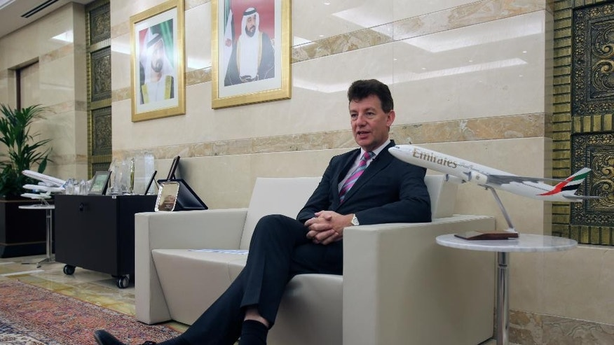 In this June 17, 2014, photo, Dubai Airports CEO Paul Griffiths, a 56-year-old Briton, talks to an Associated Press reporter at his office in Dubai, United Arab Emirates. Now that he's had a taste of running the world's busiest air hub for international passengers, Griffiths is determined to hang on to the honor while setting his sights on an even bigger prize: beating Atlanta for the title of busiest airport on the planet. (AP Photo/Kamran Jebreili)
