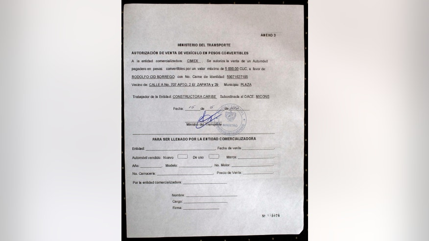This July 3, 2014, photo, shows a letter of authorization belonging to Rodolfo Cid, allowing him to purchase a vehicle in Havana, Cuba. Cid had a grand plan to augment his family's meager income by driving a taxi, but feels betrayed by a new automobile pricing scheme that has put the dream of buying a car out of reach for him and nearly everyone else on the island. (AP Photo/Franklin Reyes)