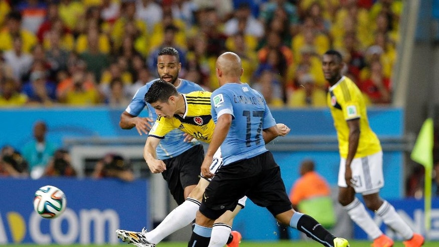 FILE - In this June 28, 2014 file photo, Colombia's James Rodriguez shoots to score his team's first goal during the World Cup round of 16 soccer match between Colombia and Uruguay at the Maracana Stadium in Rio de Janeiro, Brazil. Rodriguez provided one of the best goals of the tournament with a swivel-and-volley move that left fans gasping in delight. (AP Photo/Antonio Calanni, File)