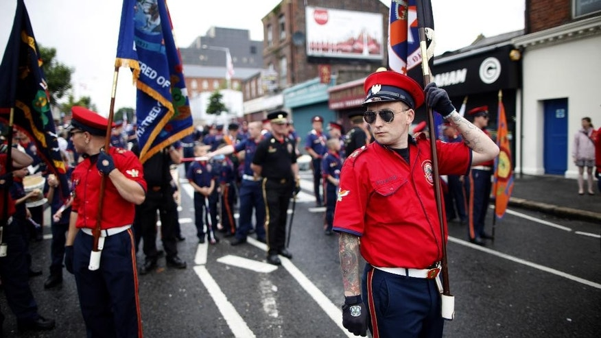 Protestant bandsmen prepare to parade in North Belfast, Northern Ireland, Saturday, July 12, 2014. Thousands of Protestant bands and Orange Order members paraded across many parts of Northern Ireland Saturday for the Twelfth of July celebrations an annual Protestant commemoration of the 1690 Battle of the Boyne. (AP Photo/Peter Morrison)