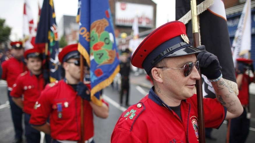 Protestant bandsmen parade in North Belfast, Northern Ireland, Saturday, July 12, 2014. Thousands of Protestant bands and Orange Order members paraded across many parts of Northern Ireland Saturday for the Twelfth of July celebrations an annual Protestant commemoration of the 1690 Battle of the Boyne. (AP Photo/Peter Morrison)