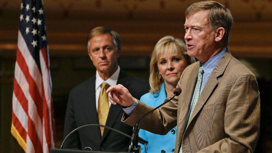Democratic Colorado Gov. John Hickenlooper, right, speaks at a news conference along with Tennessee Gov. Bill Haslam, left, and Oklahoma Gov. Mary Fallin, both Republicans, at the National Governors Association convention on Friday, July 11, 2014, in Nashville, Tenn. The governors are holding their annual meeting in Nashville through Sunday. (AP Photo/Mark Humphrey)