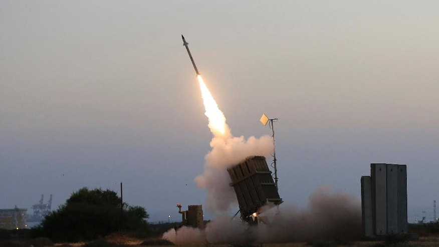 FILE - In this file photo taken July 5, 2014, an Iron Dome air defense system fires to intercept a rocket from Gaza Strip in the costal city of Ashkelon, Israel. Israel says its punishing air assault on Hamas militants, their property and their weaponry has delivered a devastating blow to the Islamic militant group. Yet rocket fire at Israel has continued almost unabated. (AP Photo/Tsafrir Abayov, File)