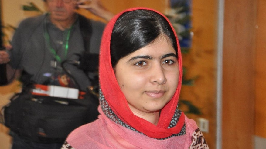 Pakistani activist Malala Yousafzai, who survived being shot by the Taliban because she advocated education for girls, visits Abuja, Nigeria, Sunday July 13, 2014. Malala Yousafzai traveled to Abuja in Nigeria to meet the relatives of schoolgirls who were kidnapped by Boko Haram three months ago. (AP Photo/Olamikan Gbemiga)