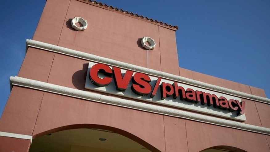 MIAMI, FL - FEBRUARY 05:  The name CVS/pharmacy is displayed on its store on February 5, 2014 in Miami, Florida. Today, CVS Caremark Corp. the nation's second-largest drugstore chain announced it will phase out cigarettes, cigars and chewing tobacco by October 1.  (Photo by Joe Raedle/Getty Images)