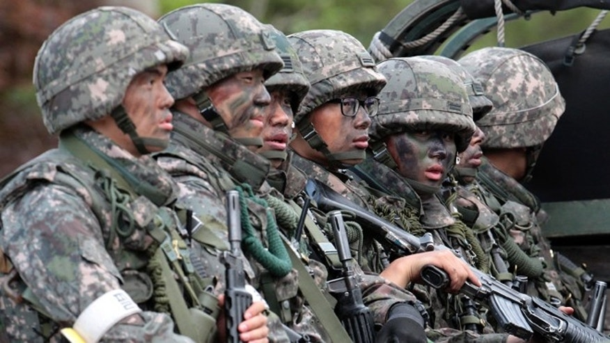 June 22, 2014: South Korean army soldiers on the truck head to search for a South Korean conscript soldier who was on the run after a shooting incident in Goseong, South Korea.