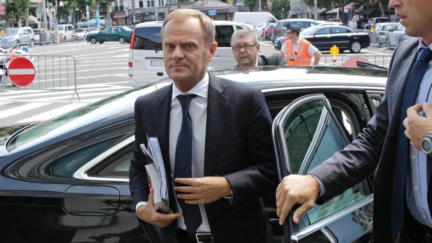 Poland's Prime Minister Donald Tusk arrives at the European People's Party summit, hours ahead of an EU summit at the European Council building in Brussels, Wednesday, July 16, 2014. European Union leaders meet to nominate their candidates for the 28-nation bloc's two top jobs. (AP Photo/Yves Logghe)