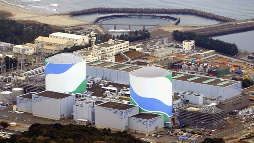 This photo taken in January, 2014 shows Sendai Nuclear Power Station in Sendai, Kagoshima prefecture, southern Japan. The nuclear power plant in southern Japan has received a passing grade for safety requirements raised after the Fukushima disaster, clearing a major hurdle toward becoming the first to restart under the tighter rules. (AP Photo/Kyodo News)