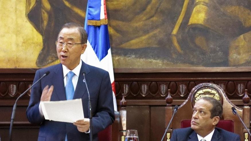 U.N. Secretary General Ban Ki-moon addresses Congress as Senate President Reinaldo Pared looks on in Santo Domingo, Dominican Republic, Wednesday, July 16, 2014. Ban asked legislators to work toward preventing Dominicans of Haitian descent from being denied Dominican citizenship. (AP Photo/Ezequiel Abiu Lopez)