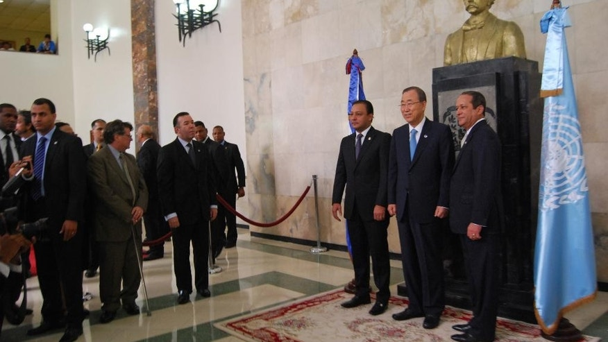 "U.N. Secretary General Ban Ki-moon, second from right, poses for photos with Lower House President Abel Martinez, third from right, and Senate President Reinaldo Pared, in front of a bust of Juan Pablo Duarte, considered the ""father of the country"" in Santo Domingo, Dominican Republic, Wednesday, July 16, 2014. Ban addressed Congress, asking legislators to work toward preventing Dominicans of Haitian descent from being denied Dominican citizenship. (AP Photo/Ezequiel Abiu Lopez)"