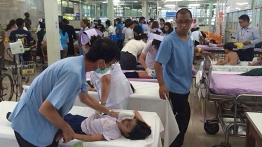 Thai doctors and nurses treat school children at a hospital after they were sickened by a chemical leak from a Hong Kong ship near their school in Laem Chabang industrial seaport in Chonburi province, southeastern Thailand Thursday, July 17, 2014. More than 90 villagers and students in nearby areas were exposed to the chemicals that spread inland before they were evacuated. (AP Photo)