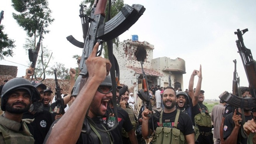 July 17, 2014: Pakistani police commandos celebrate a successful operation against terrorists in Lahore, Pakistan. (AP)