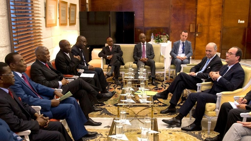 French President Francois Hollande, right, meets with Ivorian opposition party leaders, Thursday, July 17, 2014 in Abidjan, Ivory Coast. Hollande began a 3-day visit to Ivory Coast, Niger and Chad on Thursday. (AP Photo/Alain Jocard, Pool)
