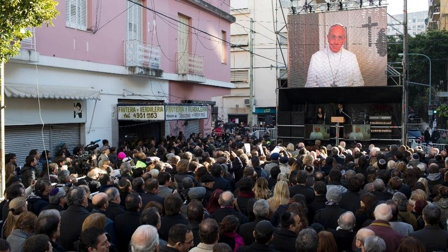 A previously recorded video is played of Pope Francis delivering a message, during the commemoration of the 1994 bombing of the AMIA Jewish Community Center in Buenos Aires, Argentina, Friday, July 18, 2014. The video message from Pope Francis was recorded on the fly by a visiting friend of the pope at the Vatican, and was aired Friday at the 20th anniversary of the unsolved bombing attack that left 85 dead. (AP Photo/Natacha Pisarenko)