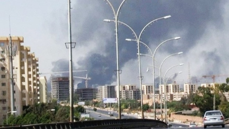 July 13, 2014: In this image made from video by The Associated Press, smoke rises from the direction of Tripoli airport in Tripoli, Libya. (AP)