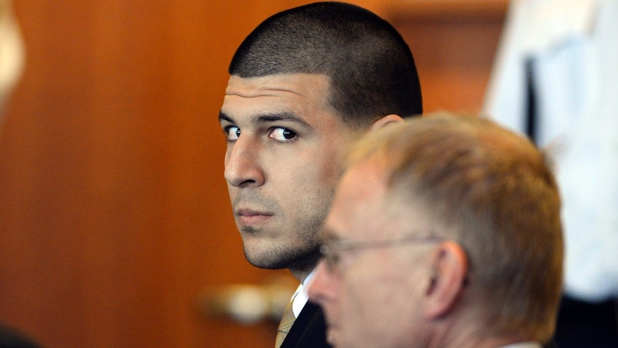 Hernandez and his attorney Charles Rankin in Bristol County Superior Court Tuesday, July 22, 2014, in Fall River, Mass.