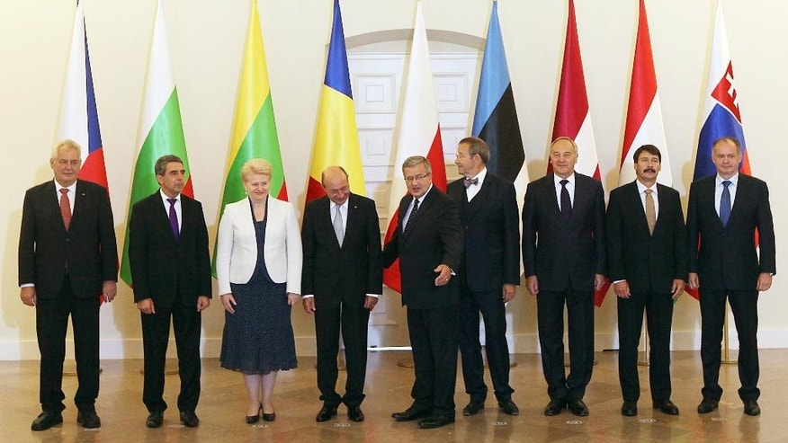 Presidents, left to right, Milosz Zeman of the Czech Republic, Rosen Plevneliev of Bulgaria, Dalia Grybauskaite of Lithuania, Traian Basescu of Romania, Bronislaw Komorowski of Poland, Toomas Hendrik of Estonia, Andris Berzins of Latvia, Janos Ader of Hungary and Andrej Kiska of Slovakia pose for the family photo during their meeting in in Warsaw, Poland, Tuesday, July 22, 2014. Presidents of the Baltic States, the Visegrad Group, Romania and Bulgaria attend the regional summit to discuss the September NATO Summit in Newport. (AP Photo/Czarek Sokolowski)