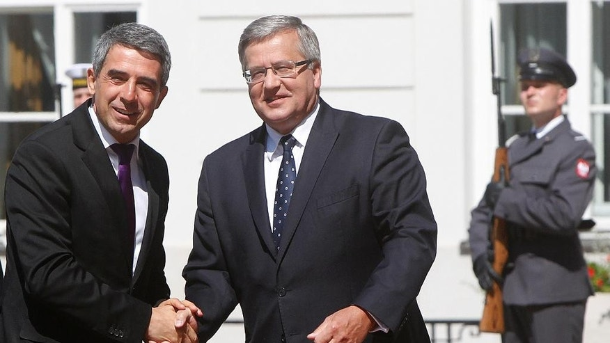 Poland's President Bronislaw Komorowski, right, welcomes Bulgarian President Rosen Plevneliev, left, during a welcome ceremony at the Presidential Palace in Warsaw, Poland, Tuesday, July 22, 2014. Presidents of the Baltic States, the Visegrad Group, Romania and Bulgaria attend the regional summit to discuss the September NATO Summit in Newport. (AP Photo/Czarek Sokolowski)