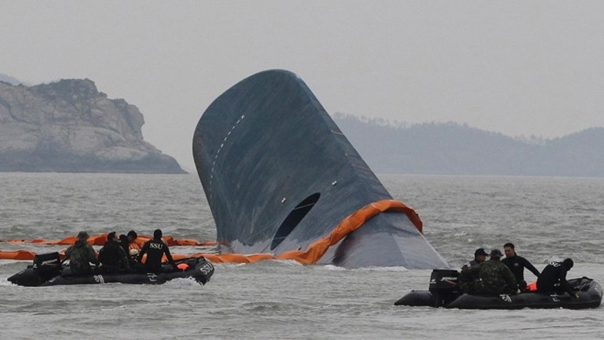 April 17, 2014: South Korean Coast Guard officers search for missing passengers aboard sunken ferry Sewol in the waters off the southern coast near Jindo, South Korea.