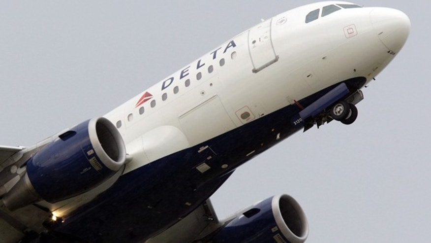 In this file photo taken July 22, 2011 a Delta Air Lines jet takes off at the Detroit Metropolitan Airport in Romulus, Mich. Delta Air Lines on Tuesday, July 22, 2014 canceled all flights to Israel until further notice, citing reports that a rocket landed near Tel Aviv's Ben Gurion Airport.