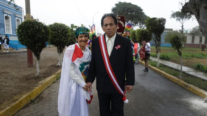 "Patients of Larco Herrera Psychiatric Hospital, one dressed to represent ""La Patria"" or ""the motherland,"" and the other as Peru's president, pose for a photo during the hospital's own Peruvian Independence Day, in Lima, Peru, Wednesday, July 23, 2014. The annual parade is organized ahead of Peru's official Independence Day celebrations on July 28. (AP Photo/Martin Mejia)"