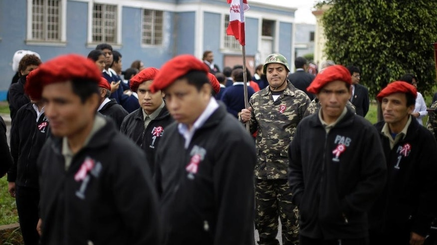 Patients of Larco Herrera Psychiatric Hospital participate in their own Peruvian Independence Day parade on hospital grounds in Lima, Peru, Wednesday, July 23, 2014. The annual parade is organized ahead of Peru's official Independence Day celebrations on July 28.  (AP Photo/Martin Mejia)