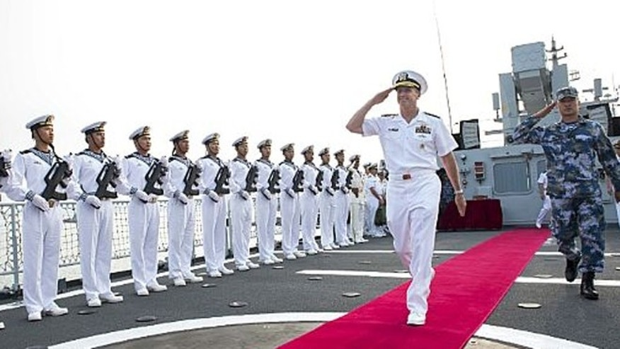 July 17: Chief of Naval Operations Adm. Jonathan Greenert departs the Chinese Datong FFG 580 with the ship's commanding officer after touring the ship. Greenert said military relations between the U.S. Navy and China have improved.