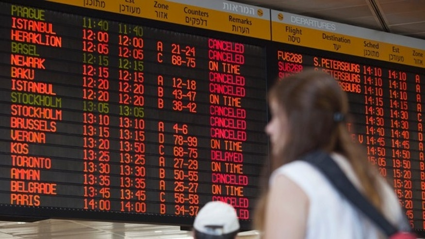 July 23, 2014: A departure flight board displays various canceled and delayed flights in Ben Gurion International Airport in Tel Aviv. (AP Photo/Dan Balilty)