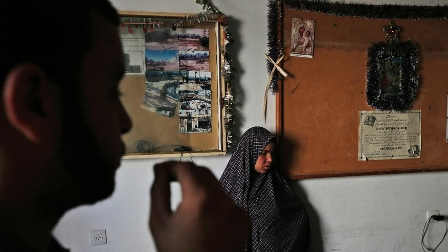 Palestinians take shelter inside the St. Porphyrios Church in Gaza City, Wednesday, July 23, 2014. Muslim families driven from their homes by the fierce fighting between Israel and Hamas are observing Ramadan in Gaza City's Greek Orthodox church. (AP Photo/Lefteris Pitarakis)