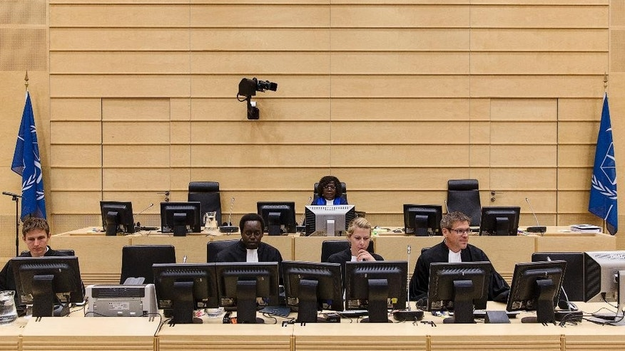 Judge Kuenyehia from Ghana, back row center, sits in the courtroom of the International Criminal Court (ICC) in The Hague, Netherlands, Thursday, July 24, 2014. Appeals judges at the ICC have upheld a decision to allow a Moammar Gadhafi-era intelligence chief to be put on trial in Libya. The appeals panel ruled Thursday that the case against Abdullah al-Senoussi should not be handled by the Hague-based court because prosecutors in Libya are pursuing similar charges against him. The ICC indicted Al-Senoussi in 2011 on crimes against humanity charges of murder and persecution allegedly committed during Gadhafi's unsuccessful attempt to put down a popular revolt against his regime. Al-Senoussi is currently in detention in Libya. (AP Photo/Michael Kooren, Pool)