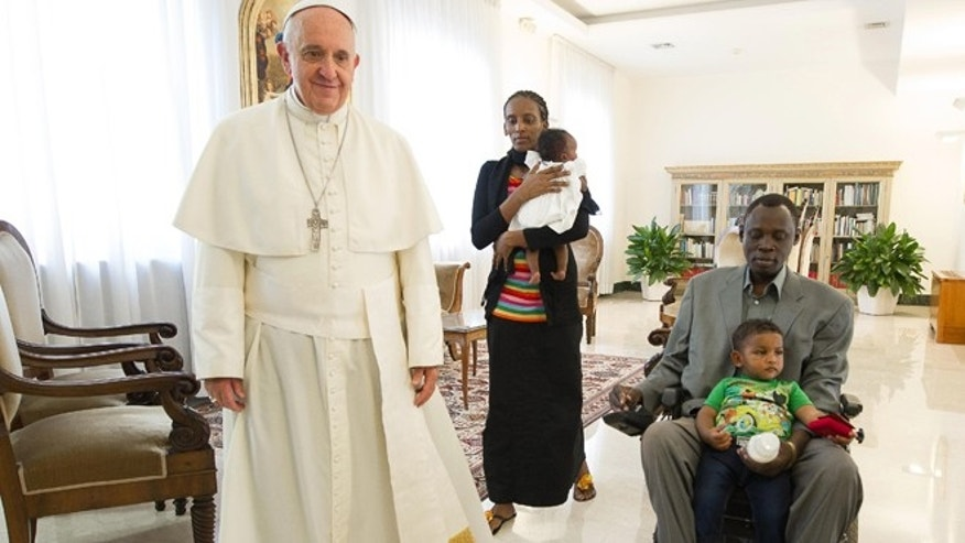 July 24, 2014: In this photo provided by the Vatican newspaper L';Osservatore Romano, Pope Francis, left, meets in his Santa Marta residence, Meriam Ibrahim, from Sudan, center, accompanied by her children Maya in her arms, Martin, and her husband, Daniel Wani, right, at the Vatican.