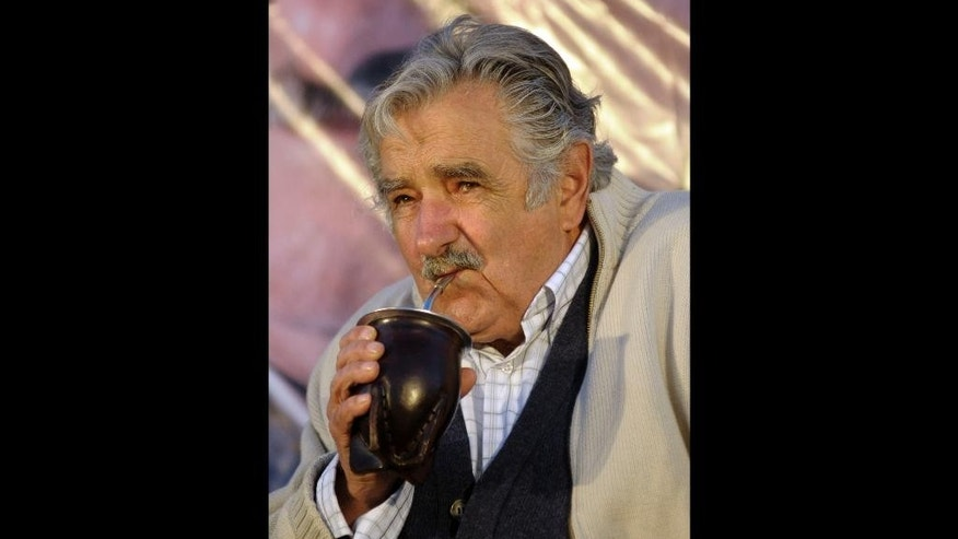 FILE - In this Oct. 22, 2009 file photo, Jose Mujica, presidential candidate for the ruling party Frente Amplio, drinks mate during a closing campaign election rally, in Pando, Uruguay. Paraguayan yerba mate producers say Mujica is thirsty for more of the traditional tea for his country and is asking them to fill the need at a lower price. (AP Photo/Matilde Campodonico, File)