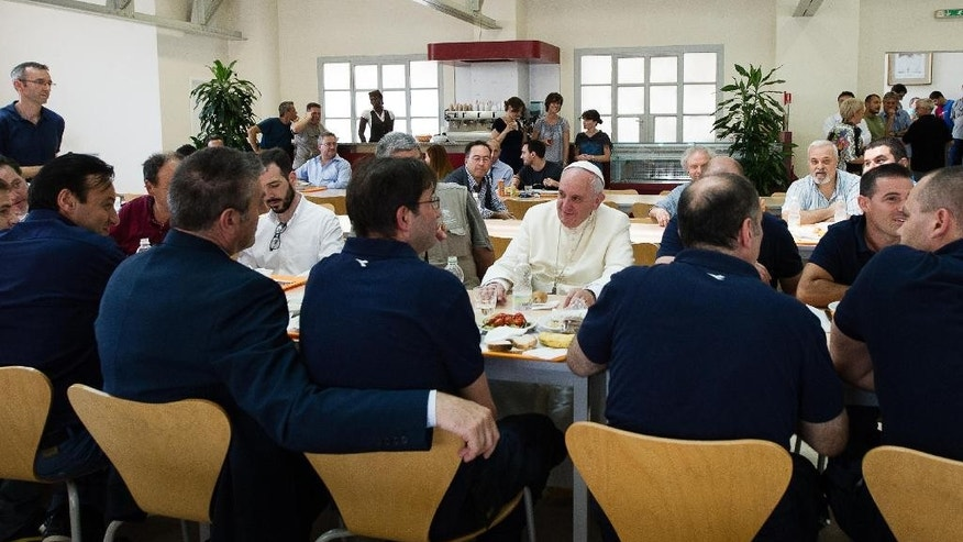 "In this photo provided by the Vatican newspaper L'Osservatore Romano, Pope Francis, center, facing camera, has lunch at the Vatican workers' cafeteria, Friday, July 25, 2014. Pope Francis got a free meal on Friday when he popped in unannounced at the Vatican workers' cafeteria and lined up, tray in hand, along with stunned diners. Cashier Claudia Di Giacomo told Vatican newspaper L'Osservatore Romano that when Francis presented his tray with a plate of cod fish, a bowl of fusilli pasta without sauce, a side of grilled tomatoes and ""just a few"" french fries she ""didn't have the courage to hand him the bill."" Francis chatted with his tablemates five Vatican pharmacy stock clerks. His tip? A papal blessing and photos snapped with diners, said the cafeteria chef, Franco Paini. The pope usually dines at the Vatican guest house where he lives. (AP Photo/L'Osservatore Romano)"