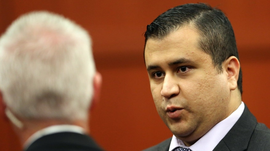 SANFORD, FL - JULY 13:  George Zimmerman (R) talks to court security investigator Robert Hemmert during a recess after a jury question in the 25th day of his trial at the Seminole County Criminal Justice Center July 13, 2013 in Sanford, Florida. Zimmerman is charged with second-degree murder in the 2012 shooting death of Trayvon Martin.  (Photo by Joe Burbank-Pool/Getty Images)