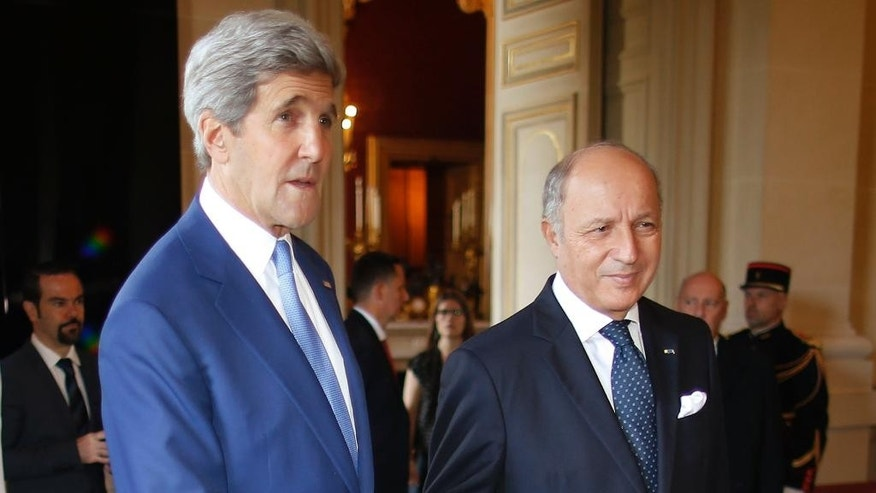 U.S. Secretary of State John Kerry, left, is greeted by France's Foreign Minister, Laurent Fabius, in Paris, France, Saturday, July 26, 2014. With a 12-hour humanitarian cease-fire in Gaza Saturday, Kerry is continuing his efforts to reach a longer truce between Israel and Hamas. (AP Photo/Charles Dharapak, Pool)