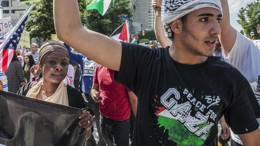 Demonstrators march and chant in support of Palestinians during a rally in Atlanta on Friday, July 25, 2014 in the wake of the war between Israel and Hamas members in the Gaza Strip. (AP Photo/Ron Harris)