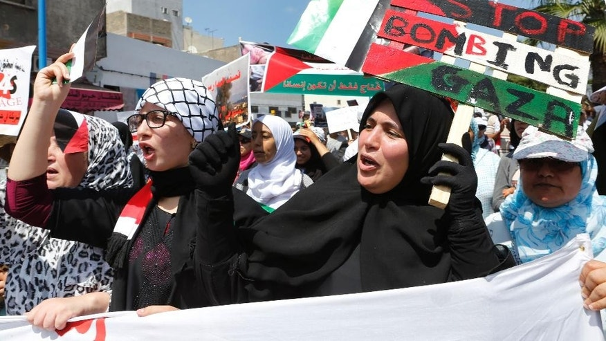 Thousands of pro-Palestinian demonstrators holds banners and shout slogans during a protest against the Israeli offensive on the Gaza Strip, in the streets of Casablanca, Morocco, Sunday, July 27, 2014. Israel and Hamas launched new attacks Sunday in the raging Gaza war, despite each side offering different truces to temporarily halt nearly three weeks of fighting ahead of a major Muslim holiday. (AP Photo/Abdeljalil Bounhar)