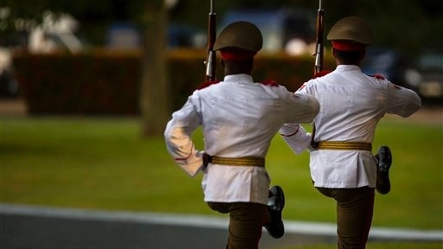 Members of the honor guard march at an event celebrating Revolution Day in Artemisa, Cuba, Saturday, July 26, 2014. Cuba marks the 61st anniversary of the July 26, 1953 rebel attack led by Fidel and Raul Castro on the Moncada military barracks. The attack is considered the beginning of the revolution that culminated with dictator Fulgencio Batista's ouster. (AP Photo/Ramon Espinosa)