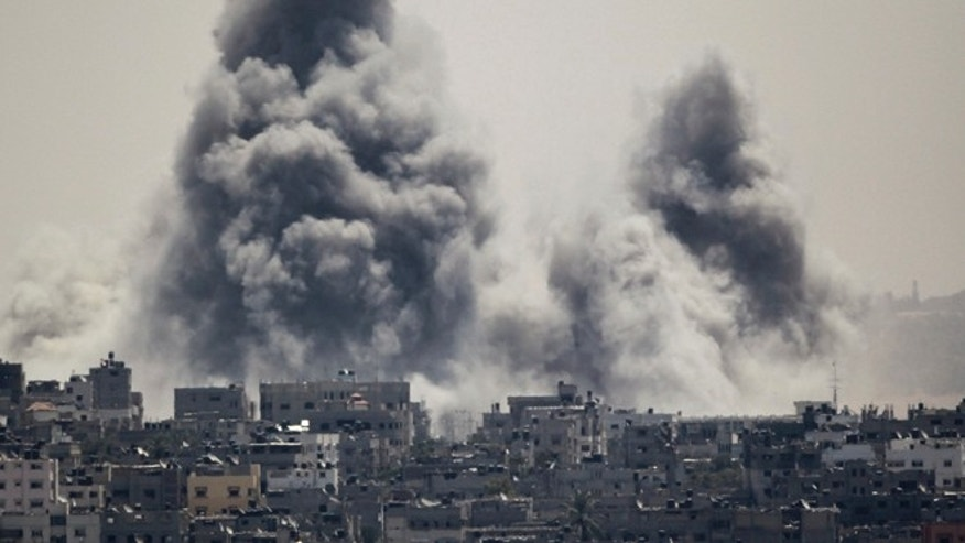 July 27, 2014: Smoke rises during an Israeli offensive in the east of Gaza City, Israel.