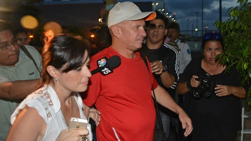July 27, 2014: Former Venezuelan general Hugo Carvajal arrives at the Queen Beatrix International Airport in Oranjestad, Aruba, after being released by authorities. Carvajal was detained in Aruba on U.S. drug charges, released by the Dutch Caribbean island Sunday and sent home, authorities said Sunday. (AP Photo/Pedro Famous Diaz)