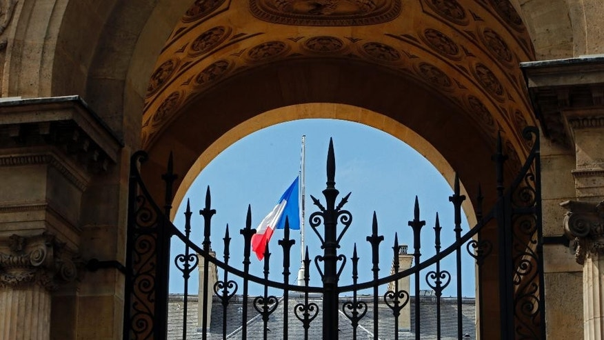 A half staff French flag flies at the Elysee Palace in Paris, France, Monday, July 28, 2014 in a show of respect for the Air Algeria flight crash, that killed all 118 people onboard including 54 French citizens. (AP Photo/Francois Mori )