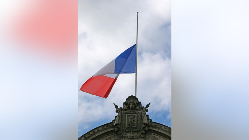 A half staff French flag flies at the Elysee Palace in Paris, France, Monday, July 28, 2014 to pay respects for the Air Algeria flight crash, that killed all 118 people onboard including 54 French citizens. (AP Photo/Francois Mori )