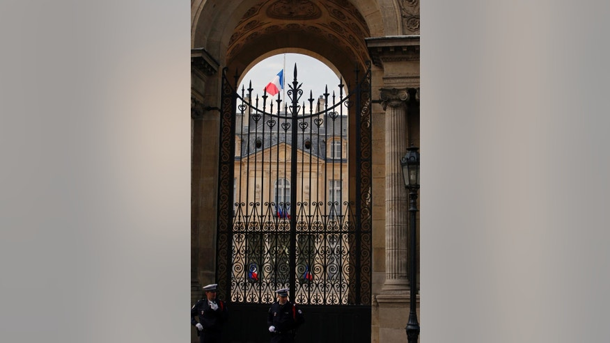A half staff French flag flies at the Elysee Palace in Paris, France, Monday, July 28, 2014 to show respect for the Air Algeria flight crash, that killed all 118 people onboard including 54 French citizens. (AP Photo/Francois Mori )